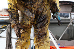 Oil covered relief worker