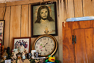 Clock and pictures in the Naquin's home on the  Isle de Jean Charles , in Louisana.