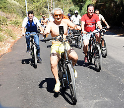 August 14, 2017 - Bodrum, Turkey - Saudi Prince Talal bin Abdulaziz Al Saud and his relatives, friends an guards ride to bike in the Aegean resort of Bodrum early on Aug. 14. Prince and his family arrived in Bodrum early today. The private jumbo jet carrying the prince and his family landed at the Milas-Bodrum Airport under tight security measures. The family got into six VIP cars and one bus waiting at the apron. They were escorted to the city center by two police vehicles and security guards. Around 300 luggage and 30 bicycles of the family were transferred to the truck only after hours. Their belongings were taken to a villa in the Göltürkbükü neighborhood. The Saudi prince and his family will reportedly stay in Bodrum for a week and will later embark on a blue voyage with a private yacht. Photo by Yasar Anter/Dha/Depo Photos/ABACAPRESS.COM