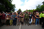 Protesters outside the drilling site run by Cuadrilla Resources, near Balcombe in South East England. Anti fracking protesters scuffled with police outside the gas exploration site.