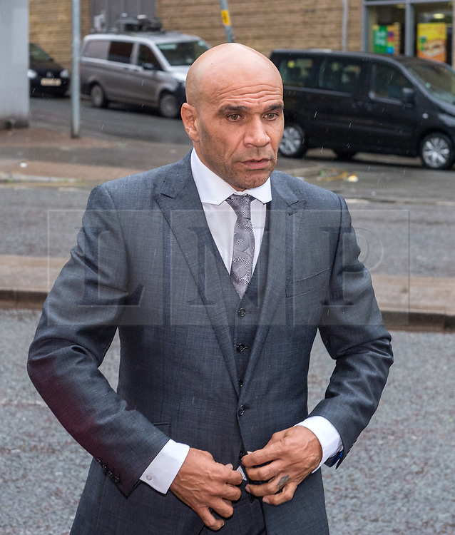 © Licensed to London News Pictures. 30/05/2018. Bristol, UK. GOLDIE, real name CLIFFORD JOSEPH PRICE, arrives at Bristol Magistrates Court to be sentenced for assaulting security guard at Glastonbury festival in 2017. His daughter, Chance Price age 20, will also appear before the court. The court previously heard the case against Miss Price would be dropped once her father had been sentenced. Goldie, a DJ and musician age 52, had previously pleaded guilty to the charge by video link from Thailand, having failed to appear before the court in March and was contacted on a video-calling app to confirm his guilty plea. He admitted assaulting bouncer Dennis Poole on June 23 2017 by beating him. The judge then told the musician, who was based in Thailand at the time, that he would have to appear in person at court to be sentenced. Photo credit: Simon Chapman/LNP