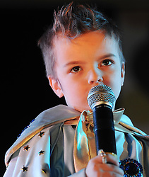 © Licensed to London News Pictures. 07/01/2012. BIRMINGHAM, UK.  John Paul Melling (5) sings to the crowds as he takes part in the annual European Elvis Championship at the Hilton Metropole Hotel at the National Exhibition Centre today.  Photo credit: Alison Baskerville/LNP