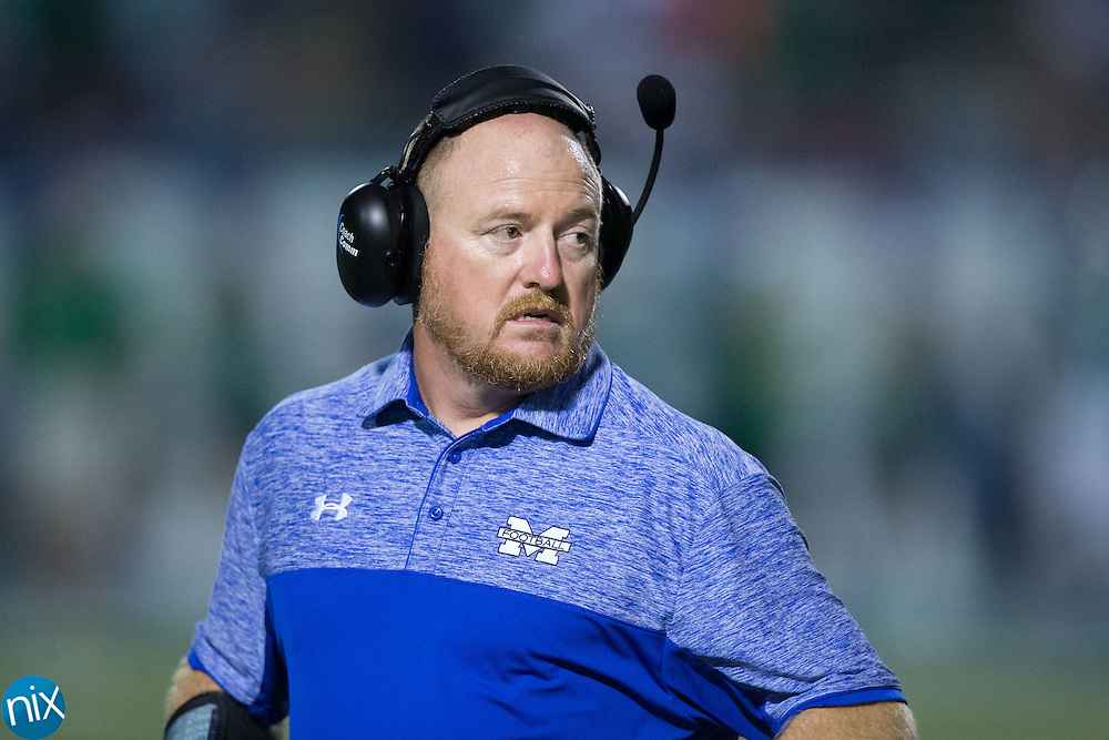 Mooresville Blue Devils head coach Marty Paxton watches from the sidelines as time runs down in their win over the A.L. Brown Wonders at Coach Joe Popp Stadium on September 9, 2016, in Mooresville, North Carolina.  The Blue Devils defeated the Wonders 23-21.  (Brian Westerholt/Special to the Tribune)