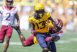 Sep 18, 2021; Morgantown, West Virginia, USA; West Virginia Mountaineers wide receiver Sam James (13) catches a pass during the second quarter against the Virginia Tech Hokies at Mountaineer Field at Milan Puskar Stadium. Mandatory Credit: Ben Queen-USA TODAY Sports