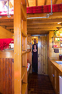 Kol Peterson and Deb Delman, owners of the Caravan Tiny House Hotel, inside the tiny house called The Caboose, Portland, OR, USA