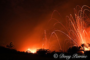 lava from Kilauea Volcano erupts at night from fissures in the east rift zone, Kapoho, Puna District, near Pahoa, Hawaii Island ( the Big Island ), Hawaii, U.S.A., blasting glowing lava bombs high above the trees, into the starry sky (some lava ejecta reached heights well above 300m or 1000 feet)