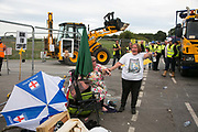 12 local activists locked themselves in specially made arm tubes to block the entrance to Quadrillas drill site in New Preston Road, July 03 2017, Lancashire, United Kingdom. Michellemartin and friend left behind police lines amongst the demolition. The 13 activists included 3 councillors; Julie Brickles, Miranda Cox and Gina Dowding and Nick Danby, Martin Porter, Jeanette Porter,  Michelle Martin, Louise Robinson,<br /> Alana McCullough, Nick Sheldrick, Cath Robinson, Barbara Cookson, Dan Huxley-Blyth. The blockade is a repsonse to the emmidiate drilling for shale gas, fracking, by the fracking company Quadrilla. Lancashire voted against permitting fracking but was over ruled by the conservative central Government. All the activists have been active in the struggle against fracking for years but this is their first direct action of peacefull protesting. Fracking is a highly contested way of extracting gas, it is risky to extract and damaging to the environment and is banned in parts of Europe . Lancashire has in the past experienced earth quakes blamed on fracking.