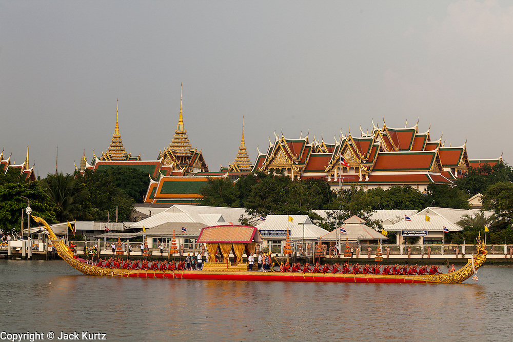 06 NOVEMBER 2012 - BANGKOK, THAILAND:  A Garuda barge built more than 200 years ago participates in the Royal Barge Procession dress rehearsal in Bangkok. The garuda barges are crewed by 34 oarsmen, 2 steersmen, 1 officer, 1 standard bearer, and two station markers. Thailand's Royal Barge Procession has both religious and royal significance. The tradition is nearly 700 years old. The Royal Barge Procession takes place rarely, typically coinciding with only the most important cultural and religious events. During the reign of King Bhumibol Adulyadej, spanning over 60 years, the Procession has only occurred 16 times. The Royal Barge Procession consists of 52 barges: 51 historical Barges, and the Royal Barge, the Narai Song Suban, which King Rama IX built in 1994. It is the only Barge built during King Bhumibol's reign. These barges are manned by 2,082 oarsmen. The Procession proceeds down the Chao Phraya River, from the Wasukri Royal Landing Place in Bangkok, passes the Grand Palace complex and ends at Wat Arun. Tuesday's dress rehearsal was the final practice for the 2012 Royal Barge Procession, which takes place November 9.   PHOTO BY JACK KURTZ