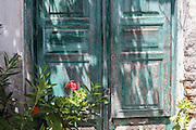 Weathered and faded green wood door