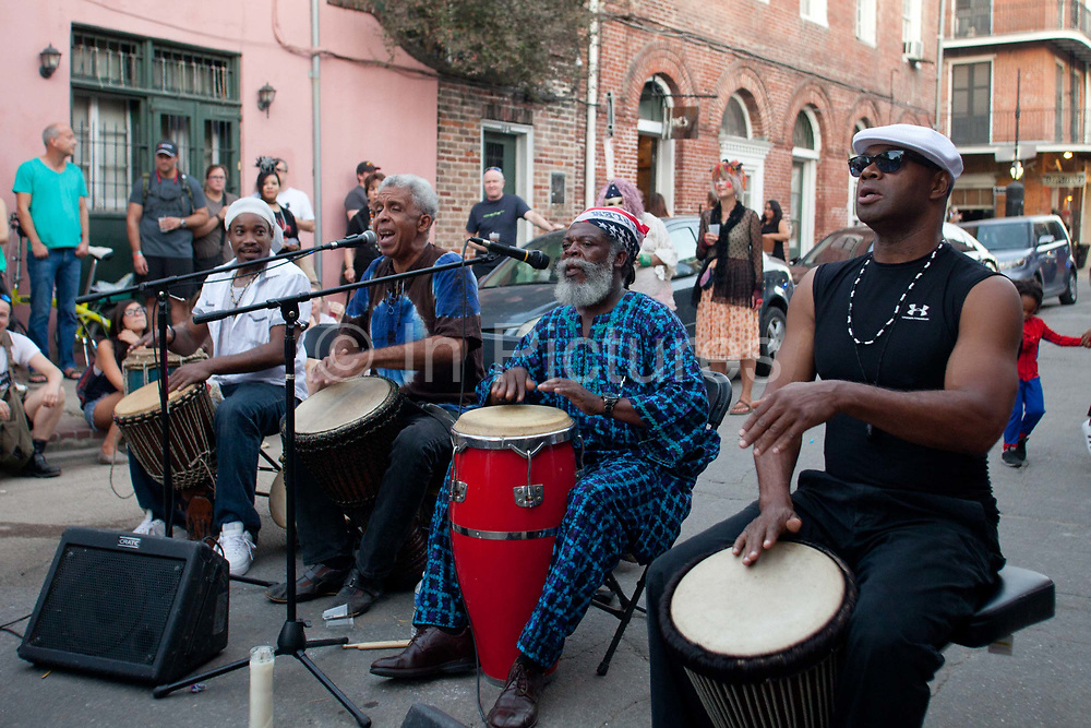 A band playing at a voodoo cultural event in the street, French Quarter, New Orleans, Louisiana, USA. walking down the street in the French Quarter,