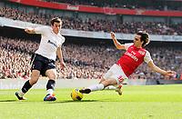 20120226: LONDON, UK - Barclays Premier League 2011/2012: Arsenal vs Tottenham.<br /> In photo: Arsenals Yossi Benayoun tussles with Tottenhams Gareth Bale.<br /> PHOTO: CITYFILES