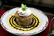 Bread pudding served at the Salt Rock Grill which overlooks The Narrows of the Gulf Intercoastal Waterway.  Indian Shores Tampa Bay Area Florida USA