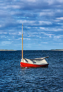 Red sailboat anchored in Chatham Harbor, Cape Cod, Massachusetts, USA.