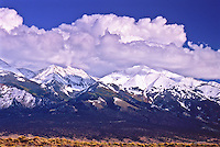 Clouds over the snow capped peaks of the Sangre De Cristo Mountains.  Viewed from the San Luis Valley, Colorado.