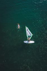 THEMENBILD - eine Schwimmerin und Windsurfer am Zeller See, aufgenommen am 01. August 2020 in Zell am See, Österreich // a swimmer and windsurfer at the Zeller See, Zell am See, Austria on 2020/08/01. EXPA Pictures © 2020, PhotoCredit: EXPA/ JFK