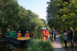 An HS2 security guard is taken away on a river boat after he removed an item belonging to an activist during tree felling works alongside HOAC lake in connection with the HS2 high-speed rail link on 21 September 2020 in Harefield, United Kingdom. Anti-HS2 activists continue to try to prevent or delay works for the controversial £106bn HS2 high-speed rail link on environmental and cost grounds from a series of protection camps based along the route of the line between London and Birmingham.