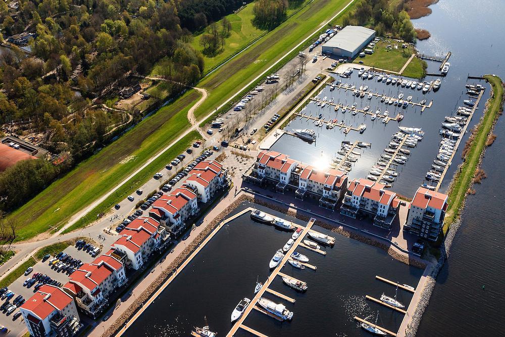 Nederland, Flevoland, Zeewolde, 01-05-2013;<br /> Vakantiepark De Eemhof van Center Parcs en jachthaven met plezierjachten en zeilboten.<br /> Holiday park Center Parcs and marina with yachts and sailboats.<br /> luchtfoto (toeslag op standard tarieven)<br /> aerial photo (additional fee required)<br /> copyright foto/photo Siebe Swart