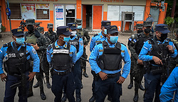 In Chamelecón the police and army patrol together. The neighbourhood has at times been the most violent neighbourhood in the world. The weekend prior to these photographs four teenagers thought to be members of a gang were shot dead in an armed confrontation with police.
