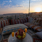Photo spot in Cappadocia with turkish carpets, mats, cushions and fruit serving, Goreme