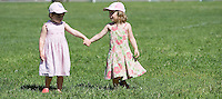 WOODBURY, CT- 02 JULY 2008- 070208JT06-.FOR COUNTRY LIFE: At left, Victoria Stepeck, 3, of Oxford, holds hands with friend Emma Bensley, also 3, of Southbury as they wait for a pony ride at the kickoff to the Woodbury Farmers Market at Hollow Park on Wednesday, July 2..Josalee Thrift / Republican-American