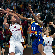 Galatasaray's Diana TAURASI (L), Ayşe CORA (R) and Lotos Gdynia's Geraldine ROBERT (C) during their woman Euroleague group A matchday 5 Galatasaray between Lotos Gdynia at the Abdi Ipekci Arena in Istanbul at Turkey on Wednesday, November 09 2011. Photo by TURKPIX