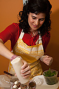 Luisa Shafi, chef and author of Lucid Food, preparing mint and rosepetal pesto with honeyed goat cheese and rosepetal shortbread.