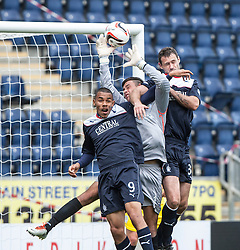 Falkirk's Phil Roberts and David McCracken with Queen of the South's keeper Calum Antell.<br /> Falkirk 2 v 1 Queen of the South, Scottish Championship 5/10/2013, played at The Falkirk Stadium.<br /> ©Michael Schofield.