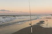 Fishing poles along the beach at sunrise on Hilton Head Island, SC