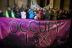 © licensed to London News Pictures. London, UK 18/01/12. A supporter of the Occupy London movement demonstrate outside St Pauls CAthedral in London on January 18th, 2012 in reaction to the High Court Ruling to uphold the City of London's Corportations bid to evict the protesters. Photo credit: Tolga Akmen/LNP