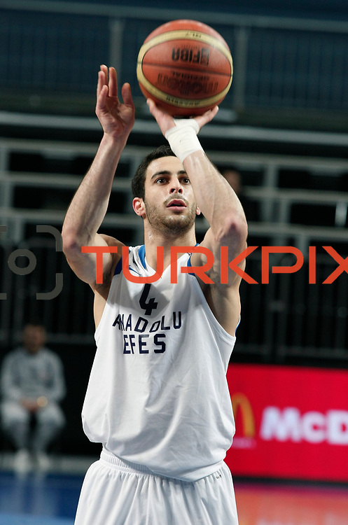 Anadolu Efes's Dogus Balbay during their Turkish Basketball League match Anadolu Efes between Turk Telekom at Arena in Istanbul, Turkey, Wednesday, January 04, 2012. Photo by TURKPIX