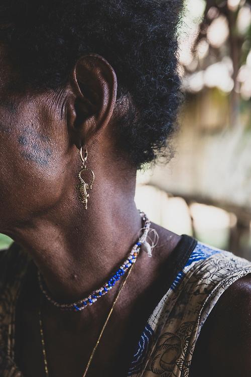 Pawara Tuwan wearing crocodile earrings in Likan, Papua New Guinea<br /><br />(June 20, 2019)