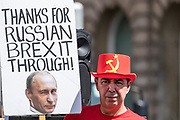 """Anti Brexit campaigner Steve Bray holds up a banner outside Parliament in Central London on Wednesday, July 22, 2020. <br /> The British government - under the Conservative Party leadership of David Cameron, Theresa May and Boris Johnson - failed to conduct serious assessments of Russian attempts to interfere with British elections, including the 2016 Brexit referendum, according to the long-delayed """"Russia Report"""" released on Tuesday. (VXP Photo/ Vudi Xhymshiti)"""