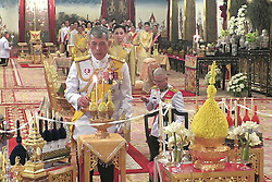 A handout photo made available by the Committee on Public Relations for the Coronation of King Rama X, shows Thai King Maha Vajiralongkorn Bodindradebayavarangkun (C) during the religious ceremony for the coronation inside the Royal palace in Bangkok, Thailand, 03 May 2019. The three-day ancient elaborate coronation ceremony of Thai King Rama X is scheduled for 04 to 06 May 2019. Editorial use only. Photo by Committee On Public Relations Fo Handout/ABACAPRESS.COM