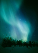 Green and purple auroral display viewed over the Talkeetna Mountains from Tahneta Pass on the night of April 13-14, 2001, Alaska.