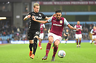 Aston Villa defender Neil Taylor (3) battles for possession  with Leeds United midfielder Ezgjan Alioski (10) during the EFL Sky Bet Championship match between Aston Villa and Leeds United at Villa Park, Birmingham, England on 13 April 2018. Picture by Dennis Goodwin.