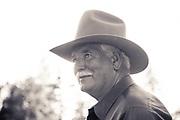 Older rancher in a cowboy hat.