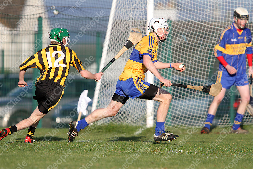 Eoin Hogan Sixmilebridge cuts across his own danger area & being pursued by Ballyea's Tadhg Lynch.<br /> Photograph by Flann Howard