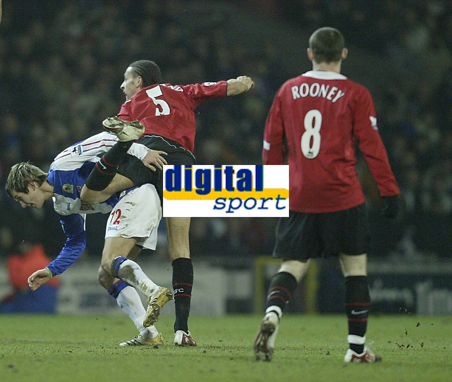 Photo: Aidan Ellis.<br /> Blackburn v Manchester United. Barclays Premiership. 01/02/2006.<br /> United's Rio Ferdinand earns his first yellow card for this challenge on Morten Gamst Pedersen