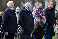 © Licensed to London News Pictures. 08/11/2020. London, UK. A man wears a union flag mask as he takes part in a minute's silence in Parliament Square as part of Remembrance Sunday .  Photo credit: George Cracknell Wright/LNP