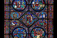 Medieval stained glass Window of the Gothic Cathedral of Chartres, France - dedicated to the life of Eustace . Central panel shows act 2 ?the Tragedy and Exile? , central diamond - After various disasters, Eustace and his family abandon their home. Top Right - possibly Eustace negotiating passage to Egypt , top right - Eustace and his family board a boat to Egypt.  Bottom left from act one ?the Conversion:?- Placidus hears the words of Christ coming from the mouth of a stag, right - Placidus is baptised and given the name 'Eustace'. A UNESCO World Heritage Site. .<br /> <br /> Visit our MEDIEVAL ART PHOTO COLLECTIONS for more   photos  to download or buy as prints https://funkystock.photoshelter.com/gallery-collection/Medieval-Middle-Ages-Art-Artefacts-Antiquities-Pictures-Images-of/C0000YpKXiAHnG2k