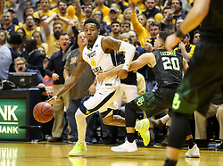Jan 9, 2018; Morgantown, WV, USA; West Virginia Mountaineers guard Daxter Miles Jr. (4) is fouled by Baylor Bears guard Manu Lecomte (20) late in the second half at WVU Coliseum. Mandatory Credit: Ben Queen-USA TODAY Sports
