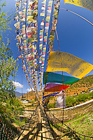 Foot bridge with prayer flags over the Paro River, Paro Valley, Bhutan