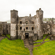 Panorama of the ramparts and courtyard at Harlech Castle in Harlech, Gwynedd, on the northwest coast of Wales next to the Irish Sea. The castle was built by Edward I in the closing decades of the 13th century as one of several castles designed to consolidate his conquest of Wales.