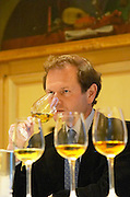 Wine tasting. Wine glasses. Pierre Lurton, Chateau Yquem, Cheval Blanc, Bordeaux, France