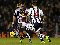 Aston Villa's Yacouba Sylla breaks away from West Bromwich Albion's Shane Long.<br /> <br /> Photo by James Marsh/CameraSport<br /> <br /> Football - Barclays Premiership - West Bromwich Albion v Aston Villa - Monday 25th November 2013 - The Hawthorns - West Bromwich<br /> <br /> © CameraSport - 43 Linden Ave. Countesthorpe. Leicester. England. LE8 5PG - Tel: +44 (0) 116 277 4147 - admin@camerasport.com - www.camerasport.com