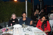 dinner guests hypnotised by Marcos Lutyens, Absolut Art Bureau cocktails and dinner to celebrate the announcement of the 2013 Absolut Art Award shortlist. Bauer Hotel, San Marco. Venice. Venice Bienalle. 28 May 2013