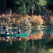 Family canoeing at Clear Lake, Oregon.
