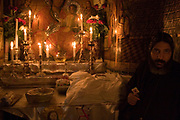Israel, Jerusalem Old City, a prayer at the Church of the Holy Sepulchre on Good Friday. Easter the procession,