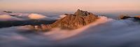 Summer fog flows over Flakstadøy, Lofoten Islands, Norway