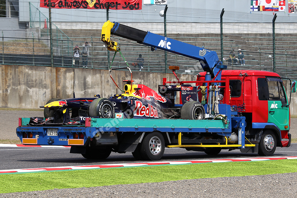 The Red Bull-Renault of Sebastian Vettel on a truck after the crash during Friday practice for the 2011 Japanese Grand Prix in Suzuka. Photo: Grand Prix Photo